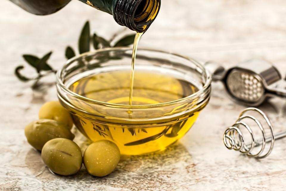 olive oil, olive, olive oil in a bowl